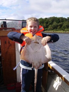 Mike aged 9, with thornback ray from Loch Etive.