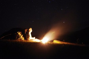 A night shot of the tent with a little campfire burning on the shoreline of Loch Etive
