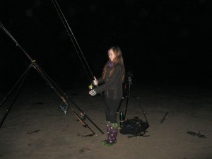 Katie fishes from Whitesands beach on a calm October night