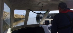 View of St Andrews ancient stone built harbour wall from Ian's Raider 18