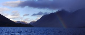A rainbow shines through the clouds on a very mixed day on Loch Etive
