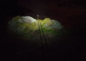Keeping an eye on the rod tips whilst night fishing from the top of Red Rock, around 60 feet above sea level.