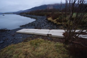 A large pontoon blocks the slate slip at Ballachulish