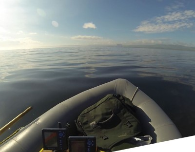 Warm sunshine, calm waters - a perfect way to spend a morning fishing from a small inflatable