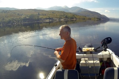 Playing a small Etive codling caught on light spinning rod