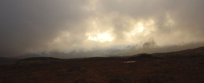 The sun disappearing behind the mountains at Rannoch Moor
