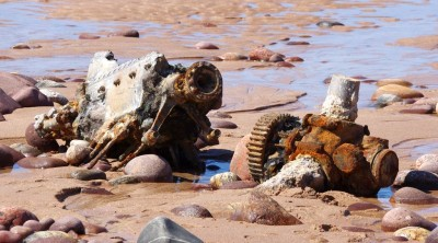 Remains of a Spitfire engine lie in the sand