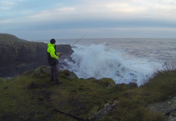 Fishing off the cliffs in rough seas