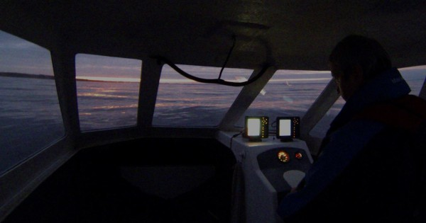 Late evening on a calm March day as we head home on Ian's Raider