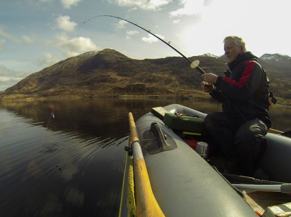 Bringing a thornback alongside the SIB, Loch Leven