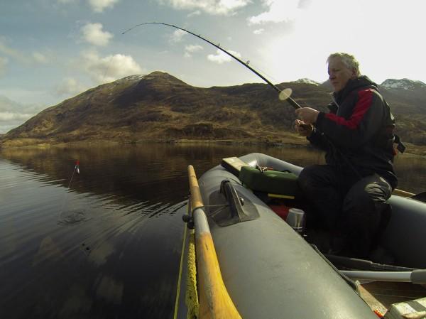 Bringing a thornback alongside the SIB, Loch Leven