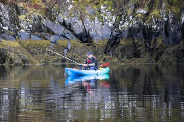 Pollack fishing from a kayak, tucked close in under the cliffs at Loch Leven