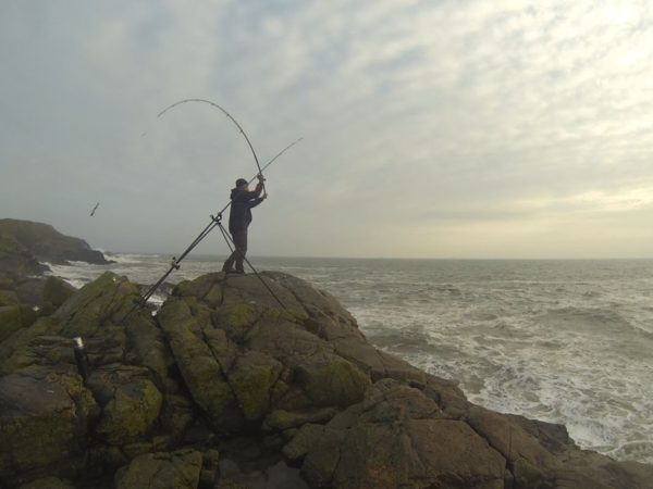Casting out a fistful of ragworm bait in search of autumn codling at Aberdeen