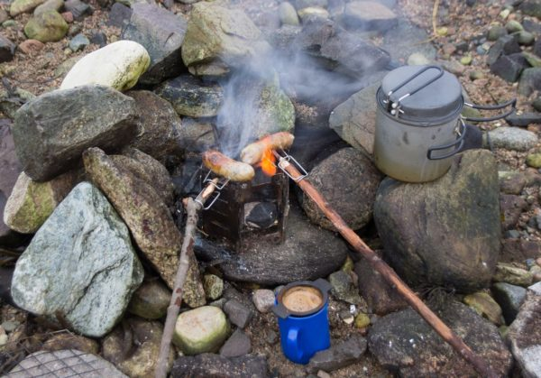 A late winter BBQ on Etive - coffee and sausages cooked over a charcoal brazier ward off the cold on a chilly day.