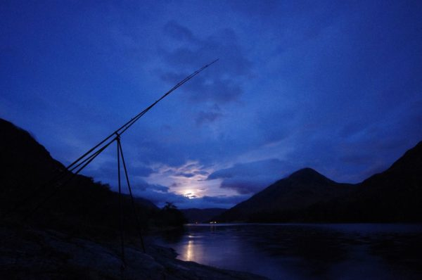 The moon rises over Loch Leven as I fish for rays early one evening