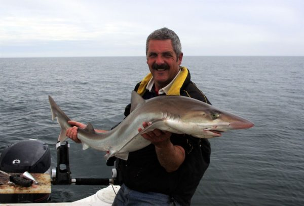 Trevor with a pack tope taken off Port William, June 2013