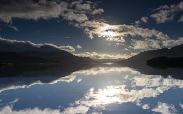 A beautiful winters day on Loch Etive, small boat fishing in mirror calm conditions near Barrs.