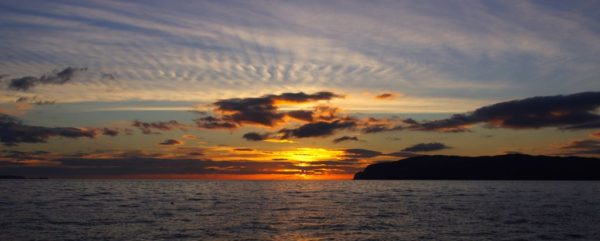 The sun sets over Mull after a warm autumn day spent chasing skate in the Sound of Mull