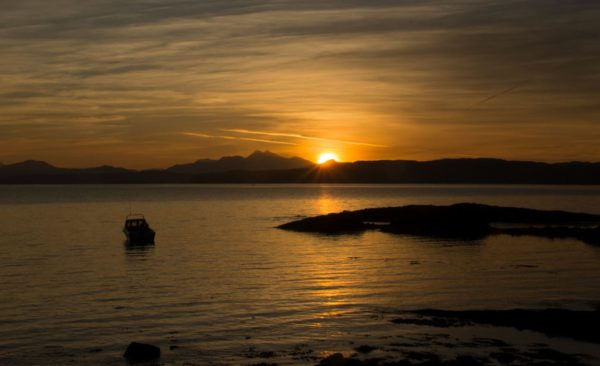 The sun rises over Ben Cruachan with Alcatraz sitting at anchor on Mull