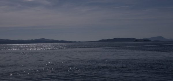 Perfect weather for a day afloat in March. A view over the islands to the south of the Firth of Lorne.