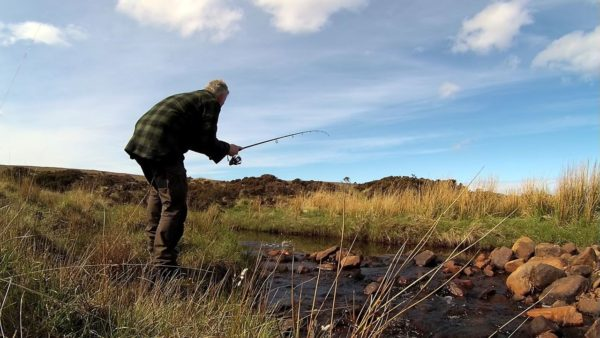 Striking into a small trout in a burn near Cape Wrath