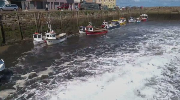 Sluice gates in the harbour are opened
