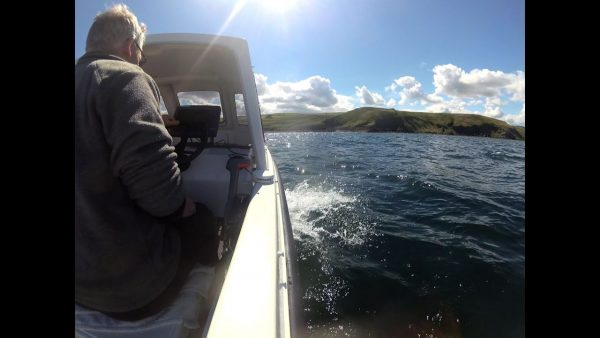 The sun shines on my new boat as we cruise along near Siccar Point, about 10 miles from Dunbar