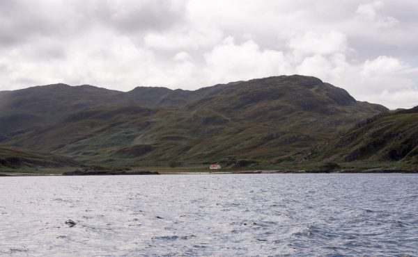 The bothy at Glengarrisdale, Jura, with its red tin roof clearly showing in this shot from the seaward side