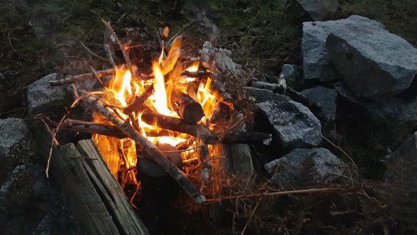 Campfire catches hold - a welcome sight on a cold November evening