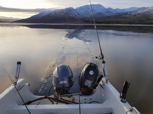 My boat is sitting at anchor on Loch Etive and carving a path through a sheet of ice floating past on the tide.