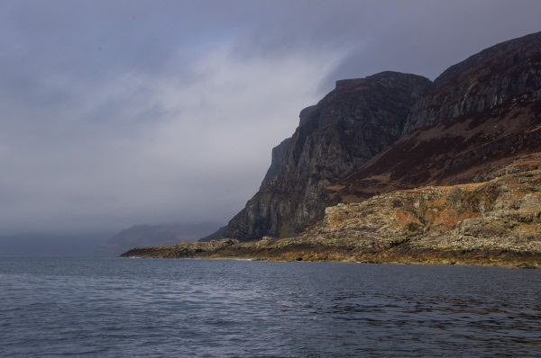 Cliffs guard the entrance to Loch Buie, Isle of Mull, and reach over 1000 feet high