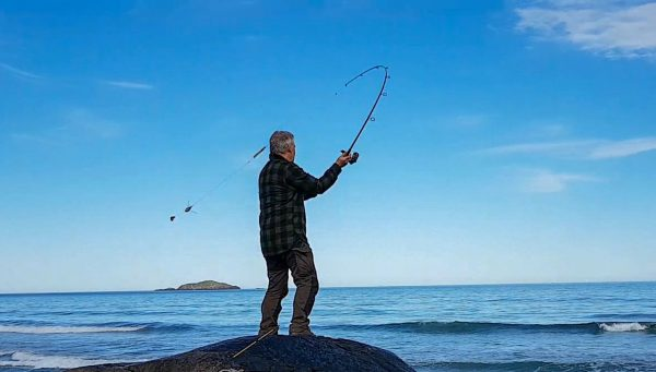 Casting out a couple of baits on a spinning rod and into the crystal clear water of the Atlantic