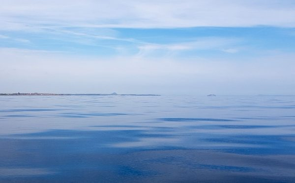 Beautiful calm sea and looking towards the Bass Rock from a spot a few miles east of Dunbar