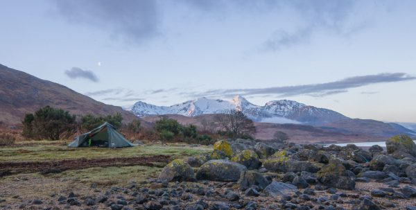 A fine campsite by the shores of Loch Etive, with a snow covered Ben Cruachan behind.