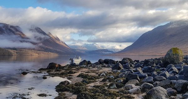 A jaw-dropping view along Loch Etive as the sun pokes through the early morning cloud