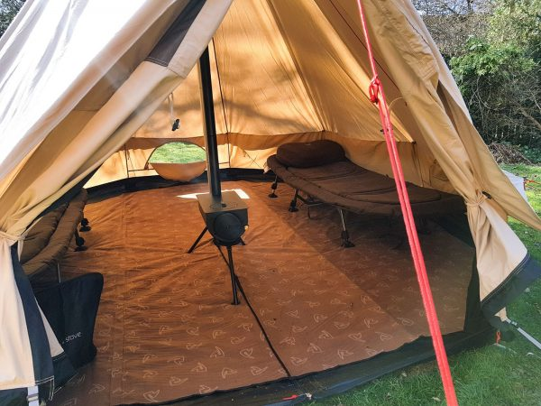 Glamping here we come - standing headroom, woodburner, carpet and beds.