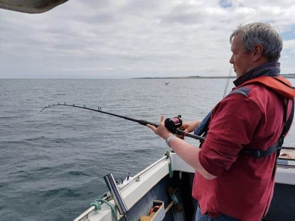 Ian fishing a baited rig for codling off St Andrews
