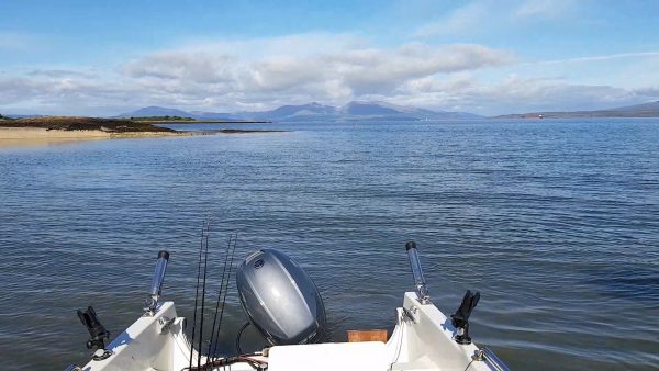 Launching into a calm sea at Gallanach, with Mull in the background