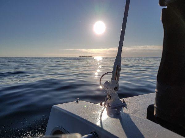 Cruising along a very calm Atlantic as the sun sets over the Torran Rocks, SW Mull