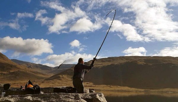 Launching a mackerel bait out into the calm waters of Loch Etive, in search of a spurdog