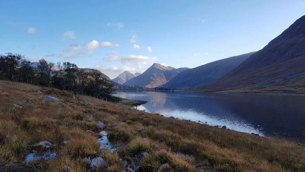 Early morning sun picks up the mountains at the head of Loch Etive