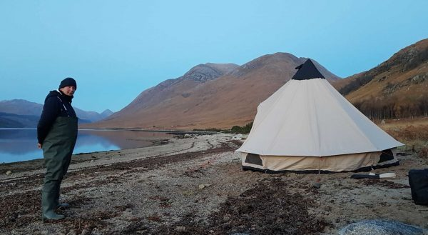 A large tent and a sandy beach don't make the best companions, but a few rocks will counter any winds tonight