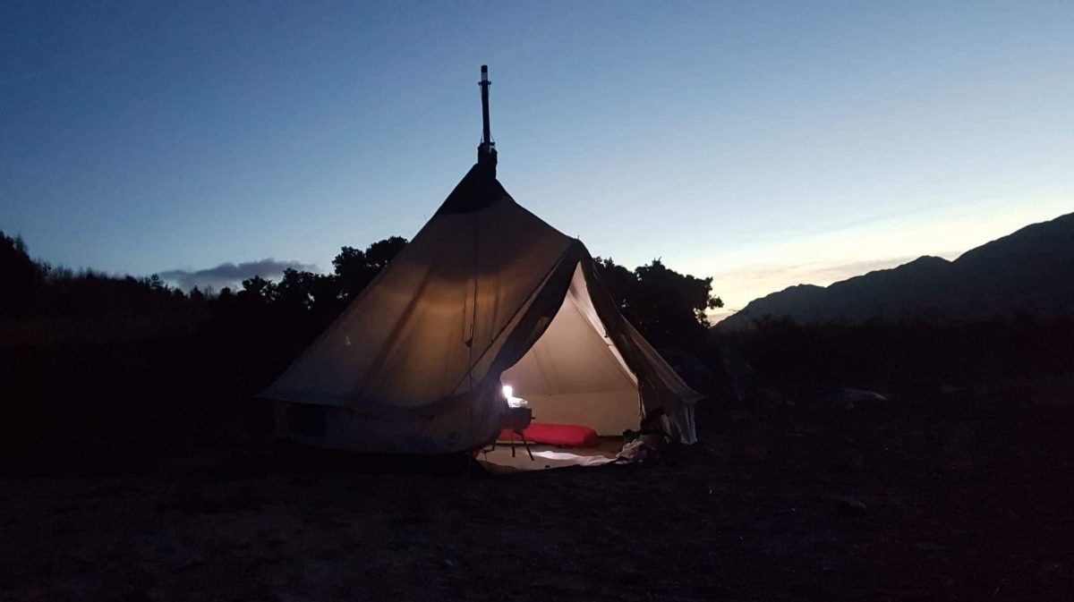 A large bell tent complete with woodburner and carpet is slight overkill for the night, but very comfortable and good fun