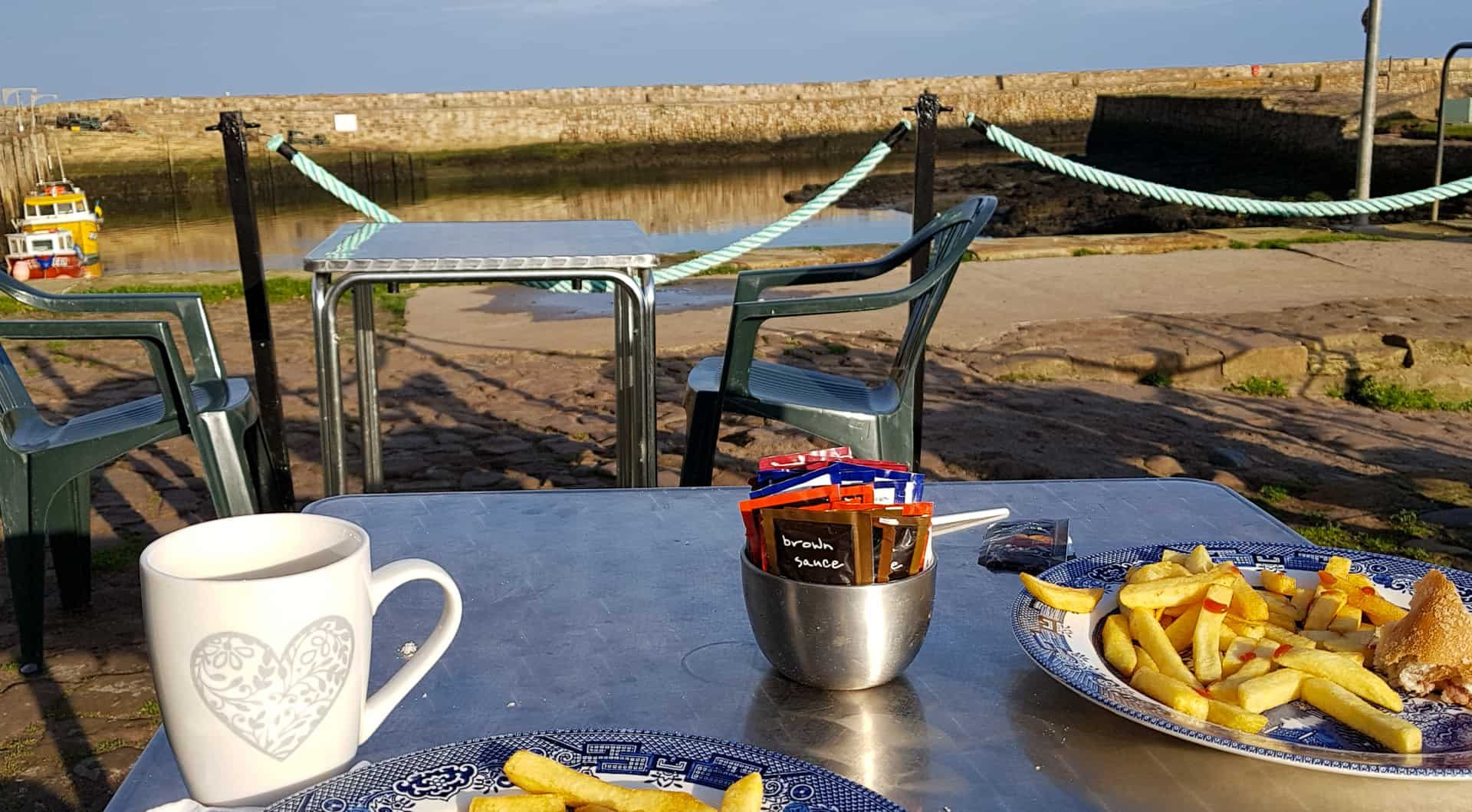 Bacon roll and chips in warm November sunshine, an excellent way to end a morning's fishing