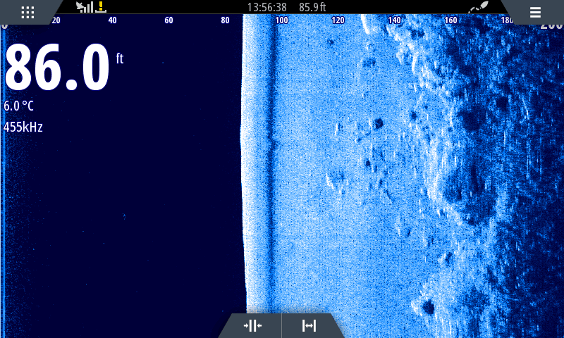 A sidescan image showing the base of rocky outcrops on Loch Leven, with boulders half sunk in the glacial mud