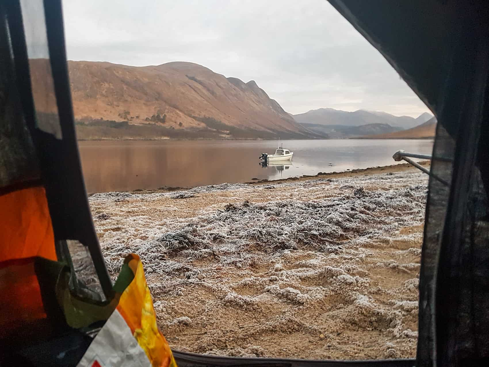 Peeking out from my tent on a cold and frosty January morning, looking north along Loch Etive towards the mountains of Glencoe