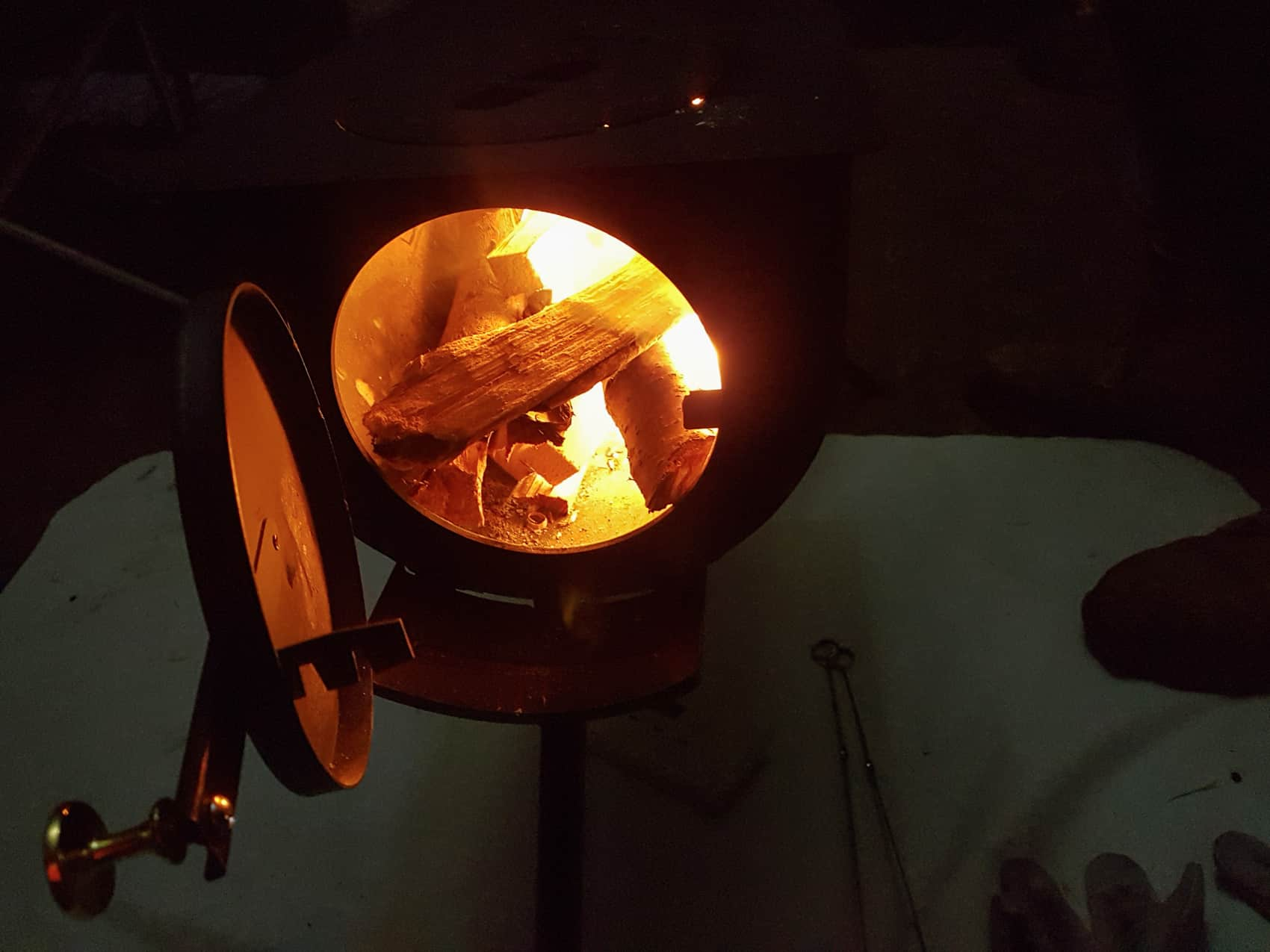 The glow of our stove provides both warmth and a boost to morale