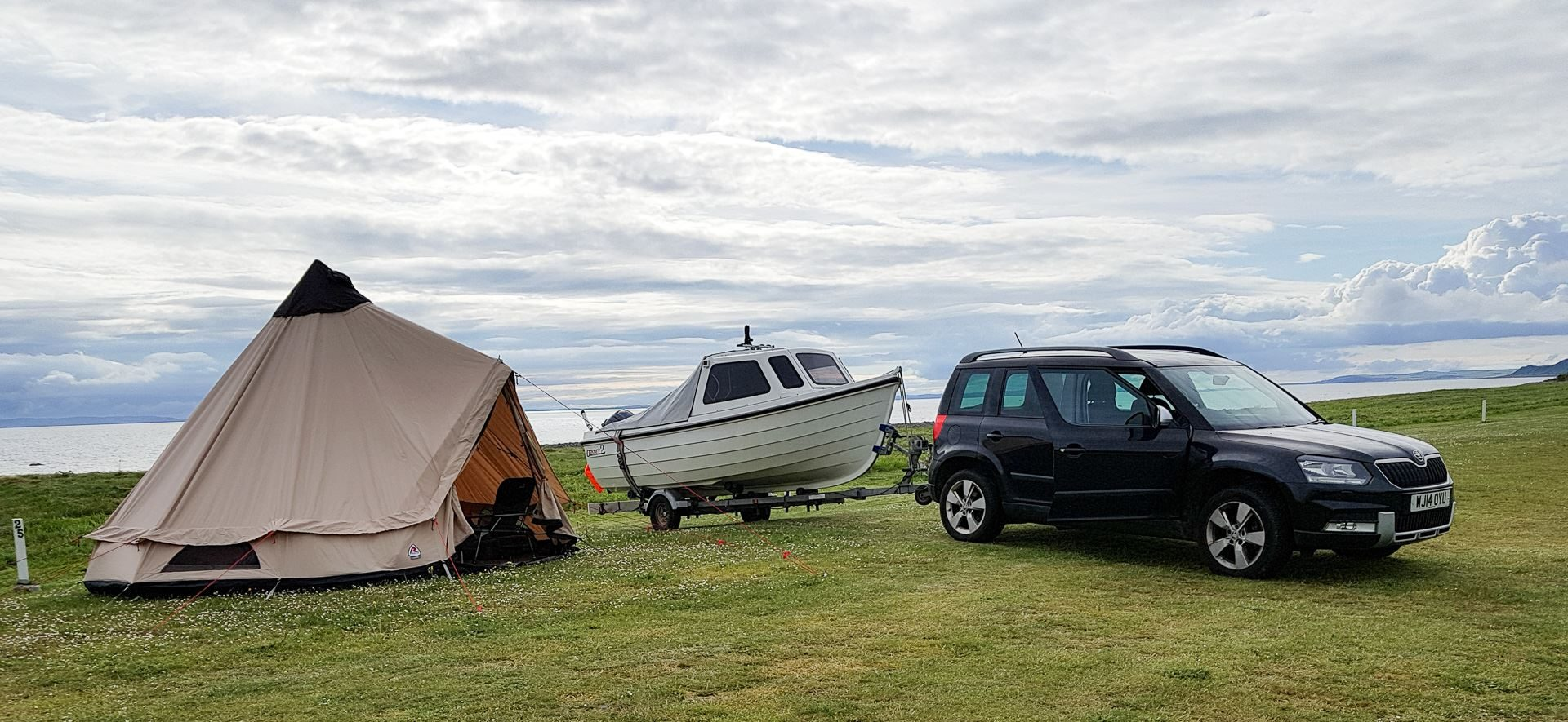 Boat, car and tent setup for the week on the shores of Luce Bay