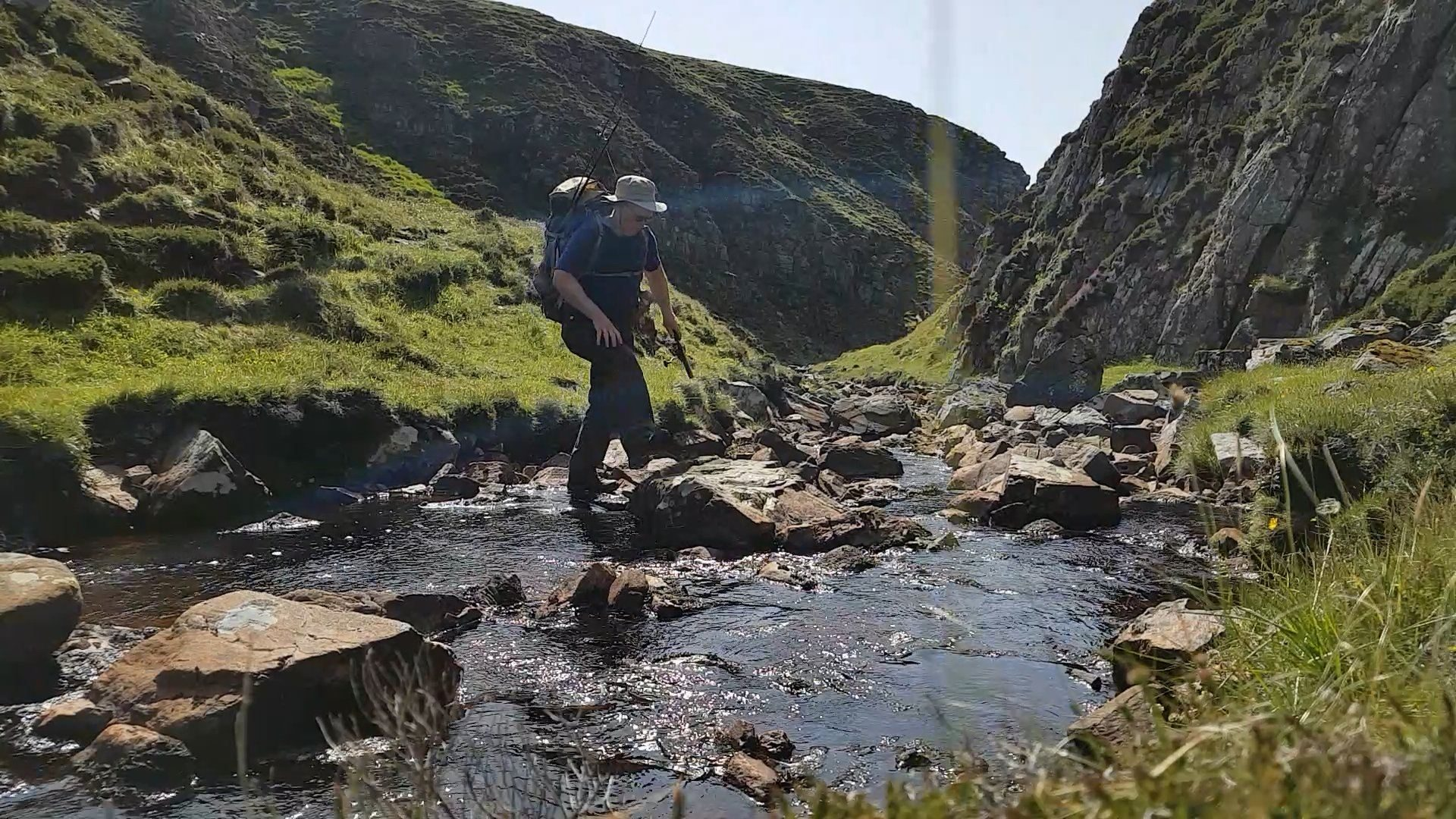 Crossing the small. steep gorge that forms the last obstacle to reaching my campsite for the night. Near Cape Wrath, NW Scotland