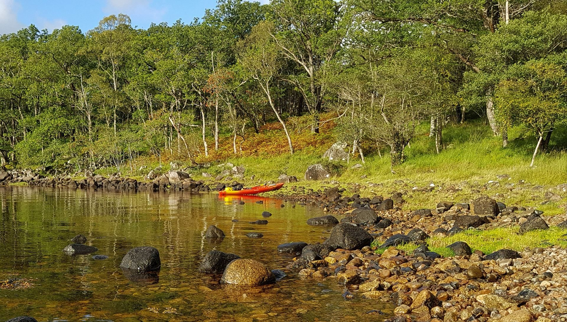 Late summer, or early autumn? Either way, my bright orange and yellow kayak adds additional colour to the scene